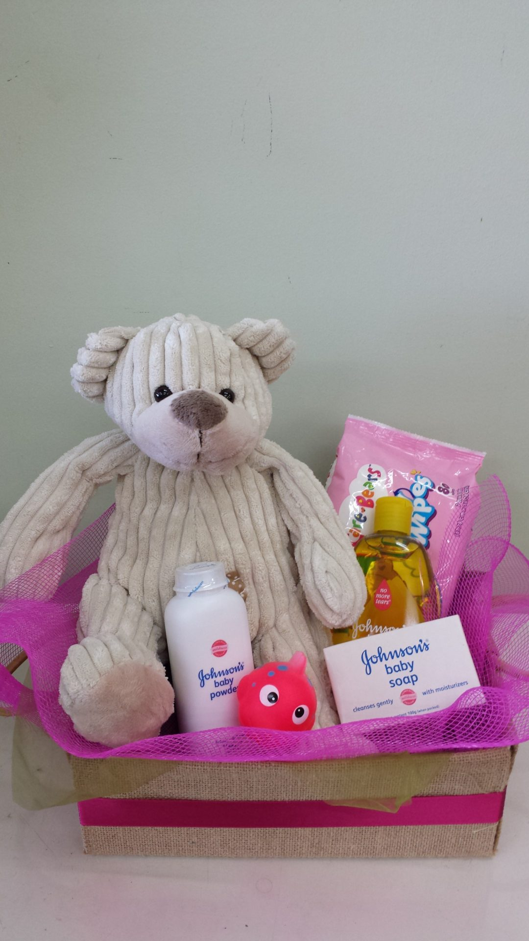 Baby care products and teddy bear