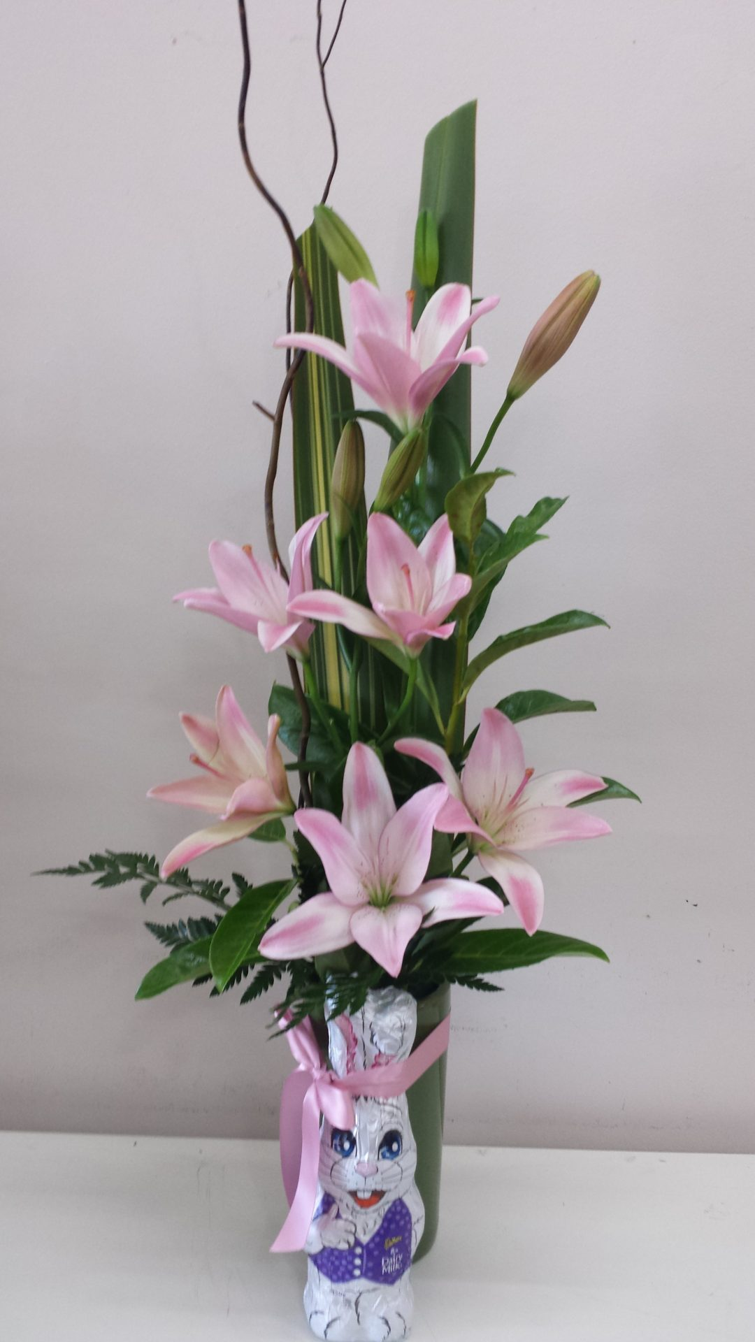 Ceramic Vase with lilies and Cadbury bunny