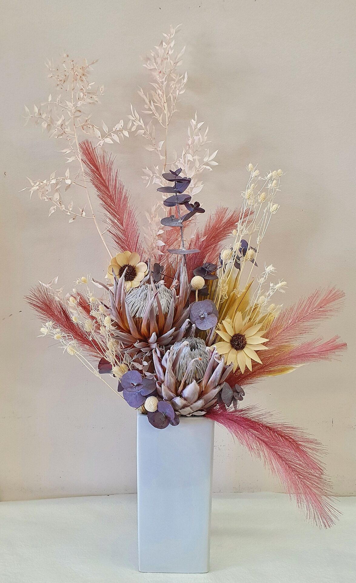 Preserved dusty pin and natural flowers